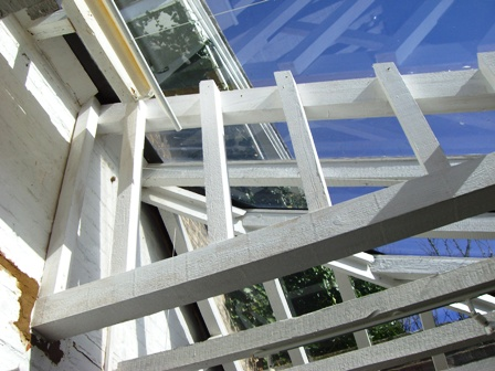 Painted new wooden struts on glass house