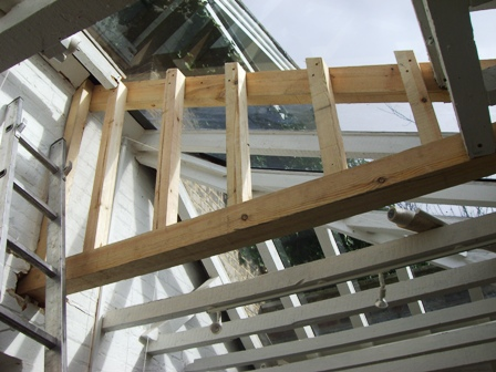 Replacement wooden strutts on glass house